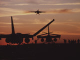 Silhouetted Planes on an Aircraft Carrier at Twilight
