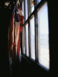 An American Flag Hangs in a Window