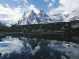 A View of the Fathi and Other Peaks Reflected in a Pond