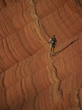 A Hiker Treks Across Sandstone Cross-Beds in Remote Pariah Canyon