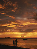 Couple Silhouetted on Beach at Twilight  Belize