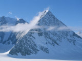 A Cloud Passes by Windblown Pyramid Peak  in Antarctica