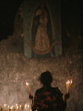 A Mexican Woman Prays to the Virgin Mary During a Religious Ceremony
