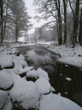 Winter Scene of Creek with Snow-Covered Banks