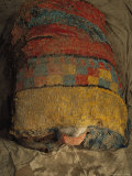 Bright Macaw Feathers Adorn the Front of a 1300-Year-Old Mummy Bundle