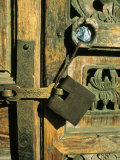A Doorway with an Ornately Carved Latch and Window
