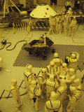 Journalists  Engineers and Technicians Examine a Robot in a Clean Room