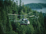 The Swirling Blades of a Helicopter Used for Logging Fill the Air