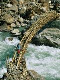 Female Hiker on Bamboo Bridge over the Marsygandi River
