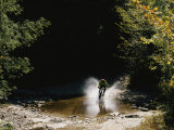 Mountain Biker Splashing Through Water at High Speed  Canaan Valley