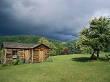 Storm Clouds Form Above a Log Cabin on the Site of French Azilum