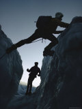 A Climber Straddles a Shallow Crevasse