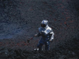 A Scientist in Full Thermal Suit and Helmet Gathers Lava Samples