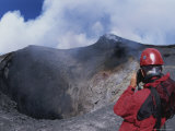 A Scientist is Seen Photographing a Crater on Mount Etna