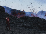 A Man Shields His Face from Falling Lava Bombs on Mount Etna