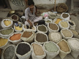 A Nepalese Vendor Sitting Among Sacks of a Variety of Legumes