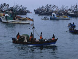 Peruvian Fishermen Head out to Their Anchored Boats off Shore