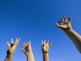 Childrens Hands Reach Toward the Blue Sky