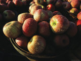 Baskets of Apples Glisten with Morning Dew at a Roadside Stand