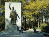 Bronze Statue of Theodore Roosevelt with Yellow Oak Leaves and Nearby Couple