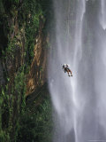 Climber Dangles on Rope Near a Waterfall in Nordeste  Brazil