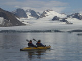 Kayakers Explore Hornsund Fjord in Svalbard