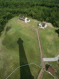 The Cape Hatteras Lighthouse Overlooking its Shadow and Grounds