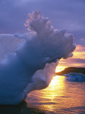 Waves and Sunlight Shape a Small Iceberg