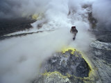 Volcanologist Probes Fumaroles on a Sulfur-Encrusted Crater