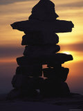 Cairn Marker Silhouetted Against the Evening Sky