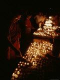 Tibetan Buddhist Monks Light Yak Butter Lamps at a Full Moon Ceremony