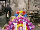 Artificial Flowers and Banners at a Funeral in Zhouzhoung