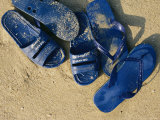 Blue Plastic Sandals  Covered in Sand  Lie on a Beach in Hong Kong