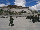Peoples Liberation Army Soldiers Walk in Front of the Potala Palace