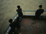 Men Stand Against the Railing of a Boat on the Yangtze River