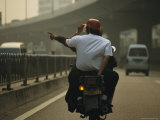 Two Men on a Motor Bike on a Smoggy Roadway in Guangzhou