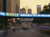 Neon Sign for Unicom Spans a Roadway at Dusk