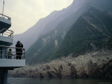 Tourists Take Photos from a Riverboat as It Passes the Three Gorges