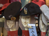 Display of Hats Perch on Cardboard Faces of the Mona Lisa