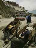 Men Sleep in Carts near Potala Palace  the Dalai Lamas Former Home