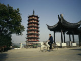 Man Cycles Past a Pagoda in Zhouzhong  China