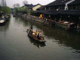 Tourists in a Traditional Boat on One of Zhouzhoungs Many Canals