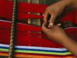 Peruvian Woman Weaving with Colorful Yarn