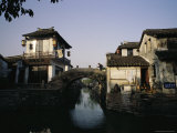 Man Crosses a Small Bridge over One of Zhouzhongs Many Canals