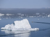 Fishing Boat Maneuvers Around Icebergs near the Ilulissat Glacier