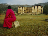 Woman Sits on a Stone near the Baldan Baraivan Monastery