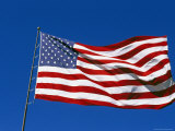 American Flag Flies in a Clear Blue Sky