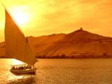 A Felucca Cruises on the Nile River at Sunset