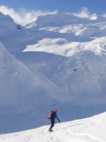 A Back-Country Snowboarder Descends a Snowfield Toward a Glacier