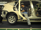 An Auto Worker Assembling a Hybrid Car at Plant in Japan